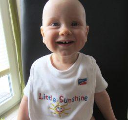 The Little Sunshine bib for SMA babies