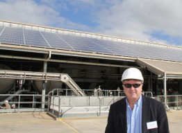 Peter Castle from SMA by the 90kW solar array.