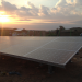 Sunset over the panels of the solar plant