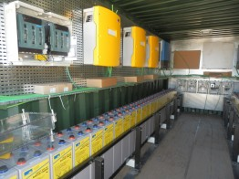 The solar power system that supplies the village with energy, contains i.a. of the inverters Sunny Island (top yellow) and the battery storage system.