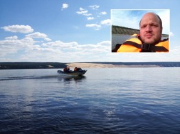 SMA employee Jan Stottko on a boat trip on the Lena River