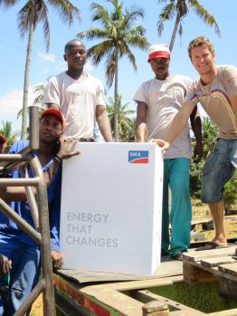 Senhor Almeide, Armando, Nelio and Ryan with the solar power inverter from SMA