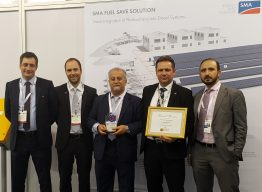 """Rewarded for good work: our colleagues Rouven Lenhart, Senior Sales Manager Hybrid Sales; Stefan Tait, Senior Sales Manager Hybrid Sales; Oussama Chehab, Vice President Sales Emerging Markets; Jörg Delbos, Head of Global Sales Hybrid; and Rabih Baroud, Regional Manager Sales EMEA, (from left to right) present the award for the best """"Solar project of the year"""" at the SMA booth at the Middle East Electricity trade fair in Dubai."""