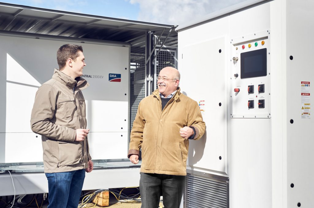 At the SMA PV farm, Jan-Hendrik Welzel and Bernhard Voll appraise the test progress of the new Medium Voltage Power Station.