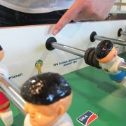 Foosball with current perimeter advertising