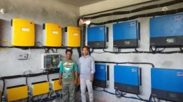 Inverter and Control room of ShouroBangla mini-grid project. In Photo: me and Devdas (site engineer of mini-grid)
