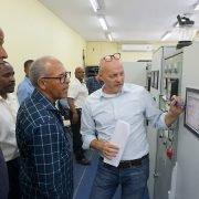 Eduard Ravelo, Managing Directo Eco Energy, Stuco-Geschäftsführer Fred Cuvaley zusammen mit den Beratern Jerry Sardine und Bart, Weijsten.
