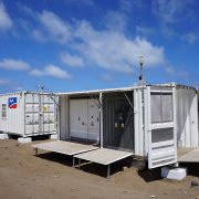 The PV system technology is compact and housed in weather-protected containers.
