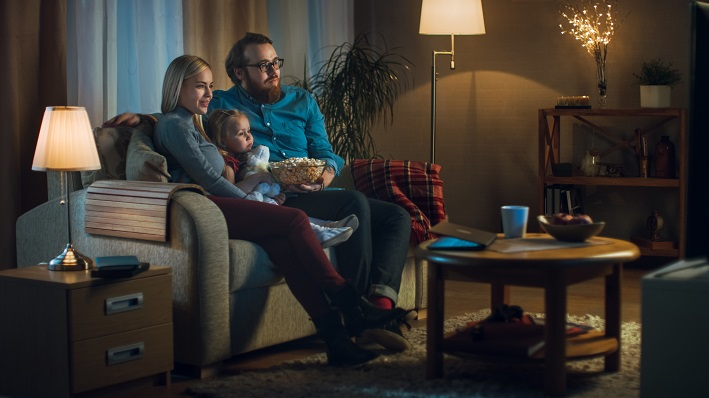 Long Shot of a Father, Mother and Little Girl Watching TV.